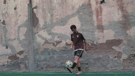 Street football players practicing crosses and shots