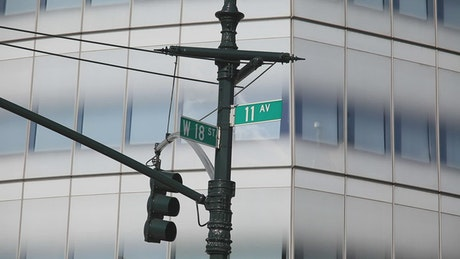 Street signs by a traffic light