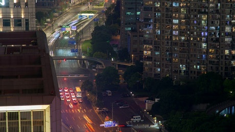 Street traffic in fast motion in a Shangai the road