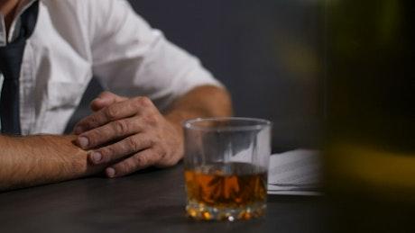 Stressed man turning to drink