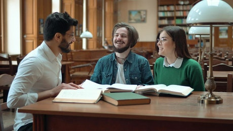 Students learn from tutor in university library