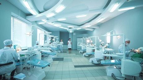 Students practicing dental procedures