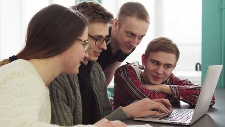Students reading a post on the internet