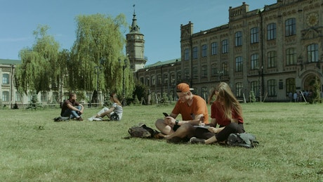 Students resting in a university garden