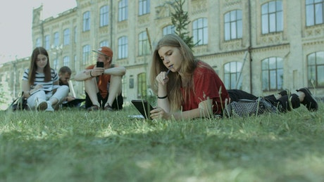 Students resting on the grass at a University