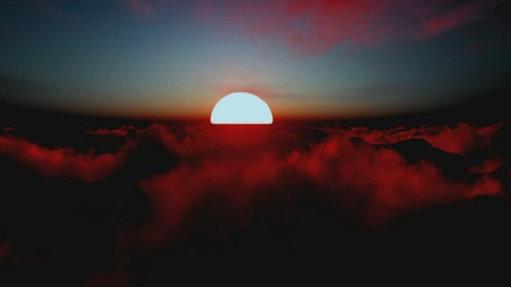 Stunning sun in the sunset over the clouds