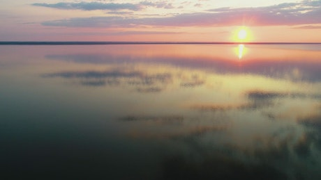 Stunning sunset reflected in a huge lake