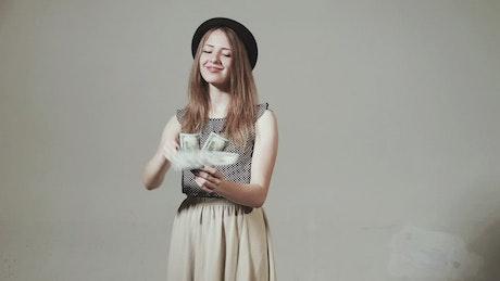 Stylish girl throwing money