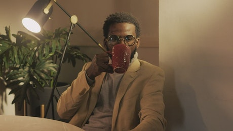 Stylish man drinking a cup of coffee