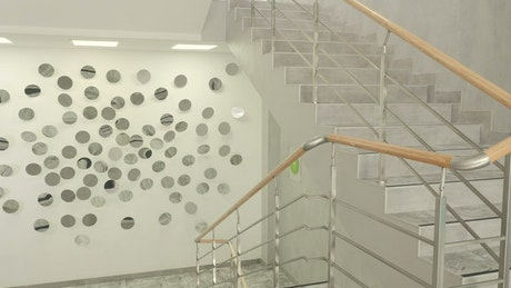 Stylish office staircase with mirrored wall