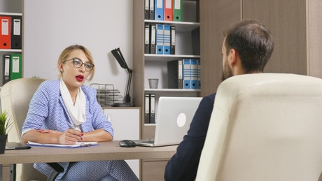 Stylish woman interviews job candidate in office