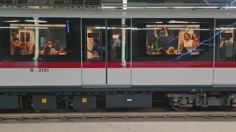 Subway cars departing from an underground station