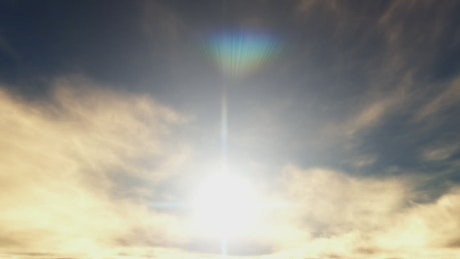 Sun flare and a cloudy sky