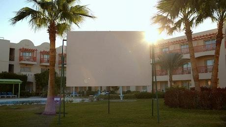 Sun flare behind a blank advertisement