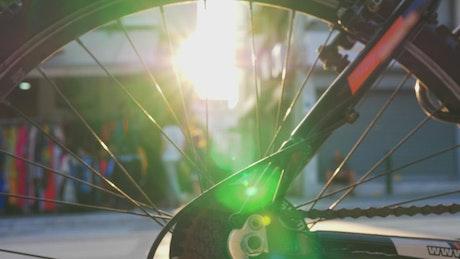 Sun flare through a bike wheel