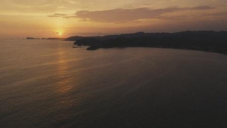 Sun set over calm beach