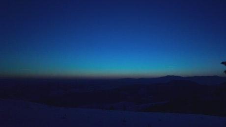 Sun shine at dawn in a winter forest