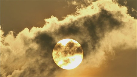 Sun shining brightly behind the clouds