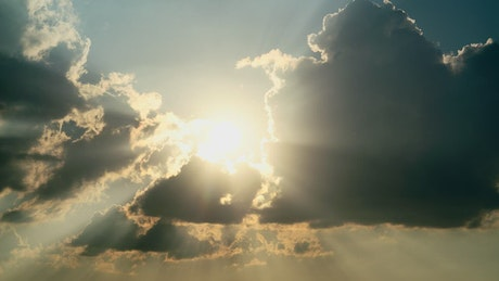 Sunbeams through moving clouds