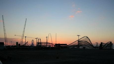 Sunrise above a rollercoaster