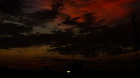 Sunrise across a deep black sky