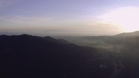 Sunrise and mist over freeway