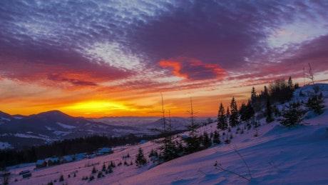 Sunrise over a winter mountain