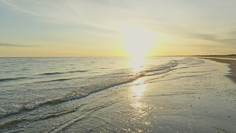 Sunrise over ocean waves