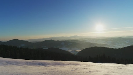 Sunrise seen from a snowy mountain
