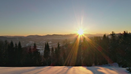 Sunrise sun flare in the snowy mountains