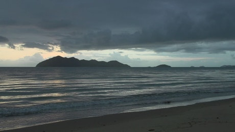 Sunrise time lapse on a cloudy day at the beach