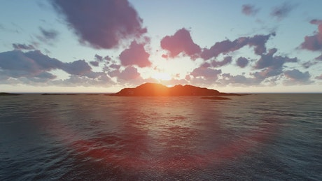 Sunset behind the mountains of an island in the sea