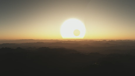 Sunset between moons and silhouettes on an alien planet