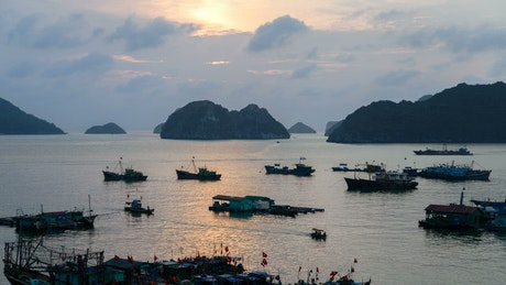Sunset in a Vietnam bay and boats