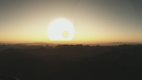 Sunset of a giant sun on an alien planet