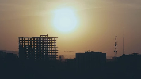 Sunset over a building under construction