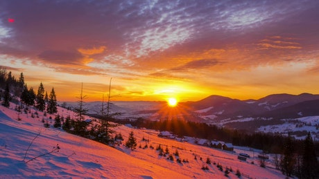 Sunset over a snowy winter mountain