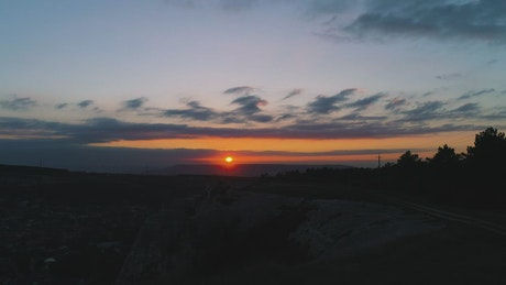Sunset over dark scenery