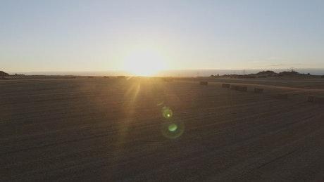 Sunset over harvested fields
