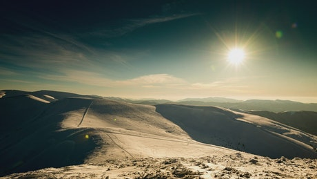 Sunset over snowy mountains, timelapse