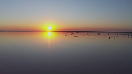Sunset reflected in a large lake
