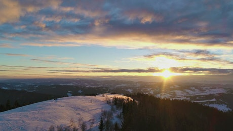 Sunset sunlit landscape in winter