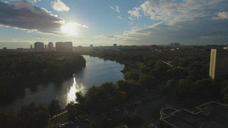 Sunshine across a city river