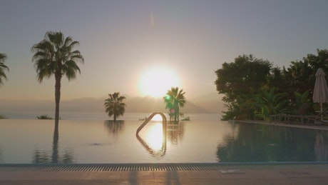 Sunshine and ripples on an infinity pool