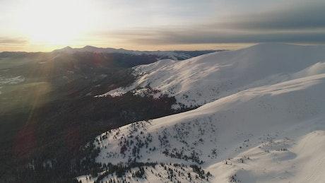 Sunshine illuminating a snowy landscape