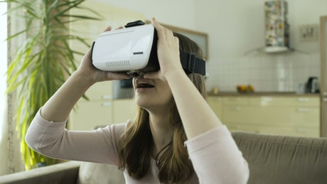 Surprised woman with vitual reality headset