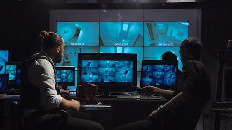 Surveillance team checking the cameras