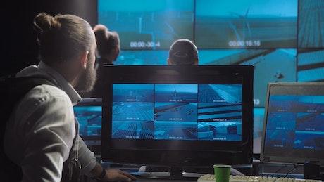 Surveillance team looking at monitors