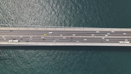 Suspension bridge with many cars, aerial shot