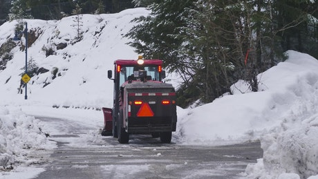 Sweeper removing snow from a road